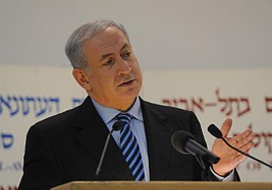 Netanyahu speaks in Tel Aviv, Monday.