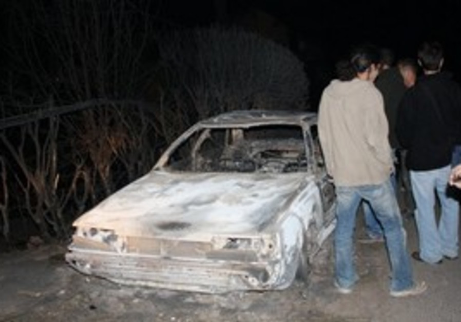 Burnt out car at Kibbutz Beit Oren