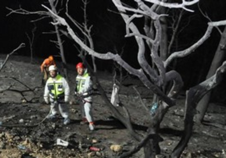 Zaka members locating remains after Carmel fires