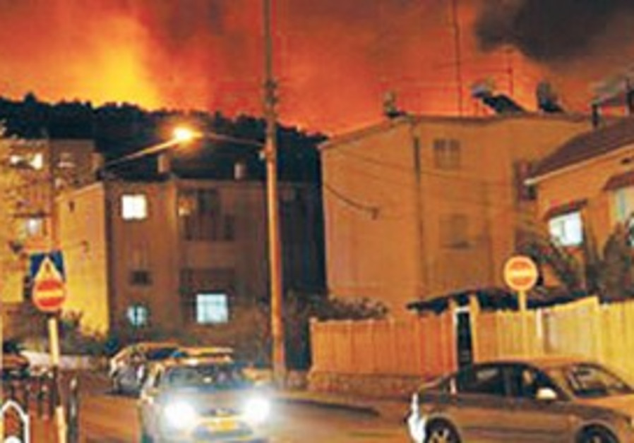 Flames approach Tirat Hacarmel as residents flee