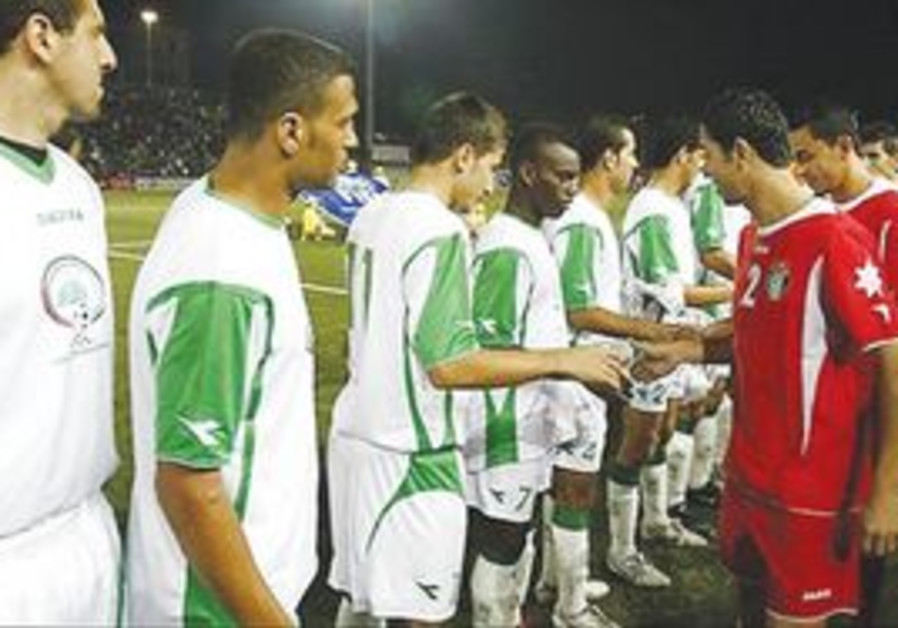 PLAYERS OF the Palestinian, Jordanian soccer teams