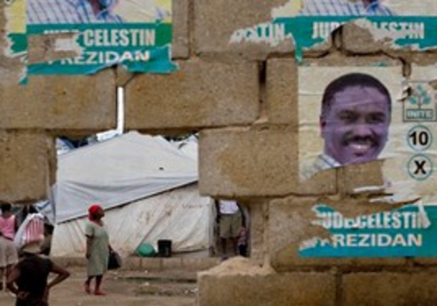 A wall covered by campaign signs of Jude Celestin.