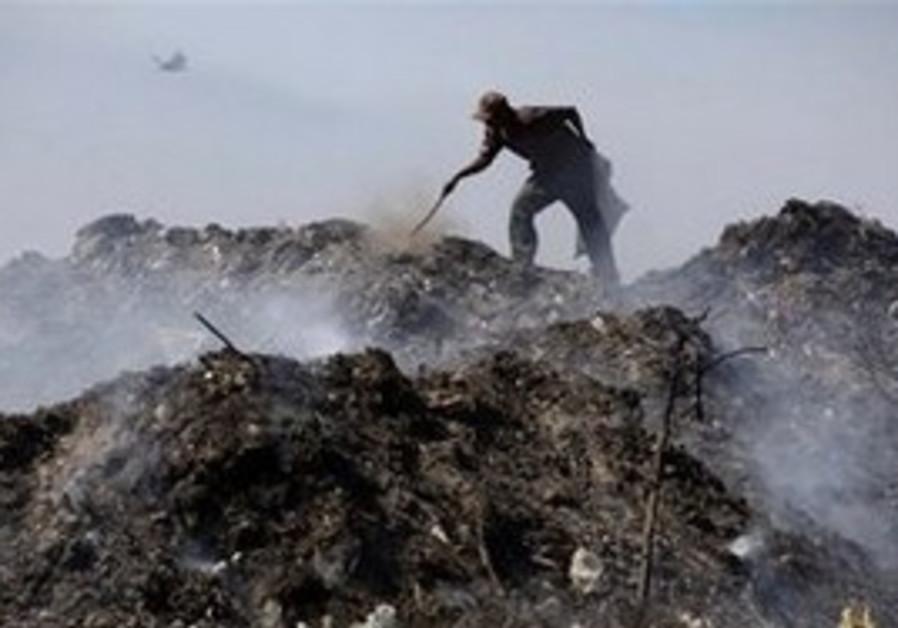Man burning trash [illustrative]