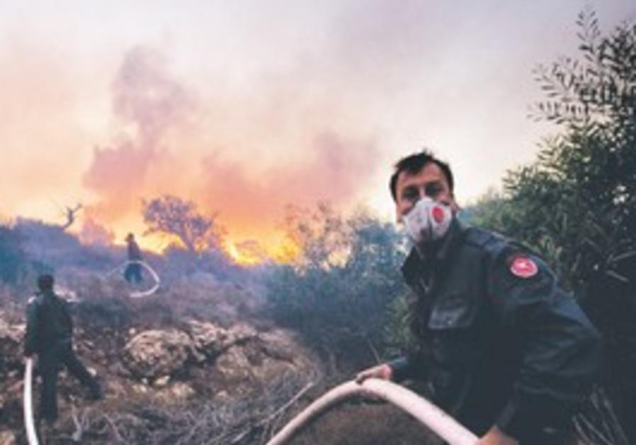Firefighters putting out blaze near Tirat Hacarmel
