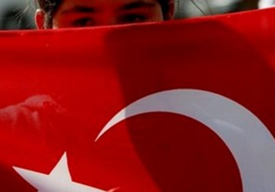 Child holding Turkish flag