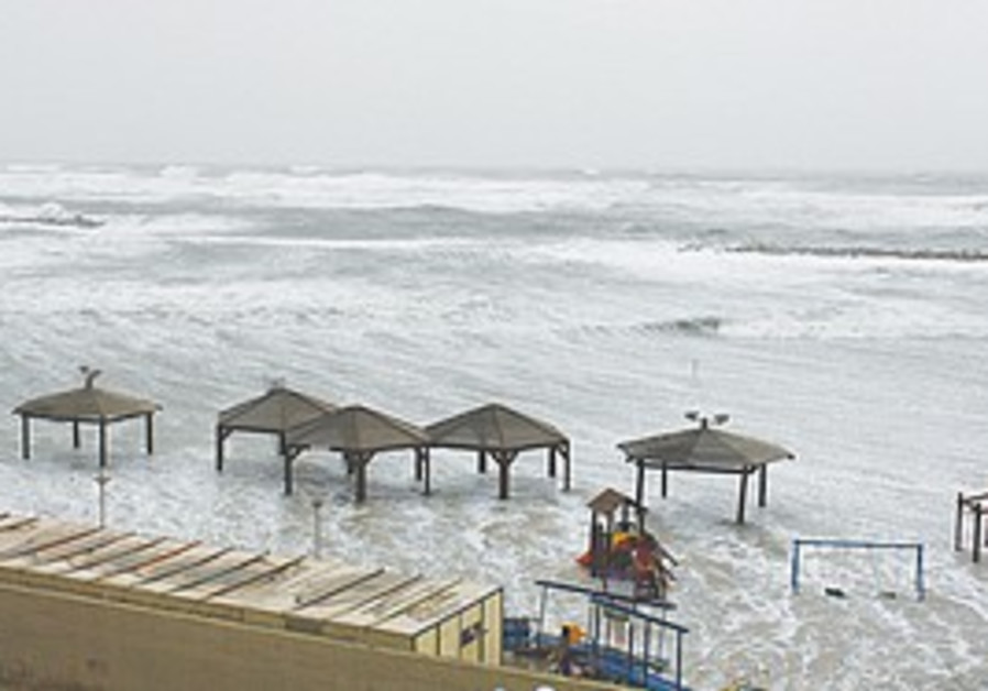 The sea engulfs Tel Aviv's Gordon Beach yesterday.