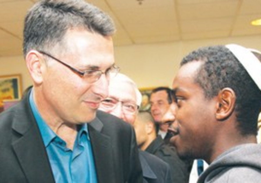 EDUCATION MINISTER Gideon Sa'ar speaks with a stud