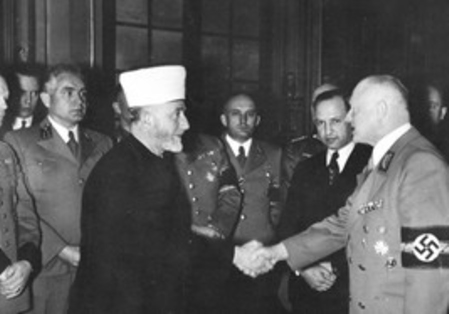 HAJ AMIN AL-HUSSEINI greets a WW2 Nazi official