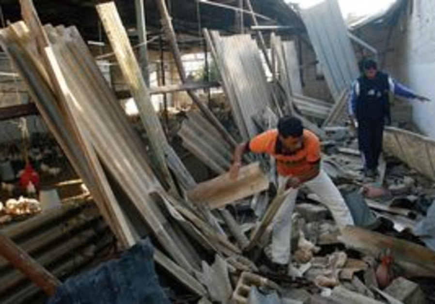 Gazan removes rubble from chicken farm
