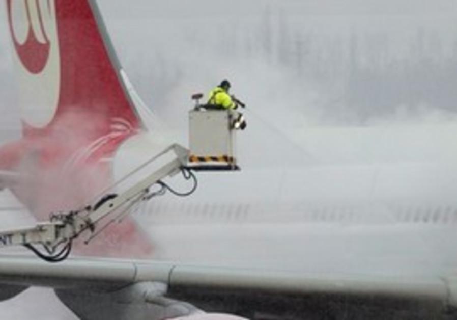 Workers de-ice an Air Berlin aircraft