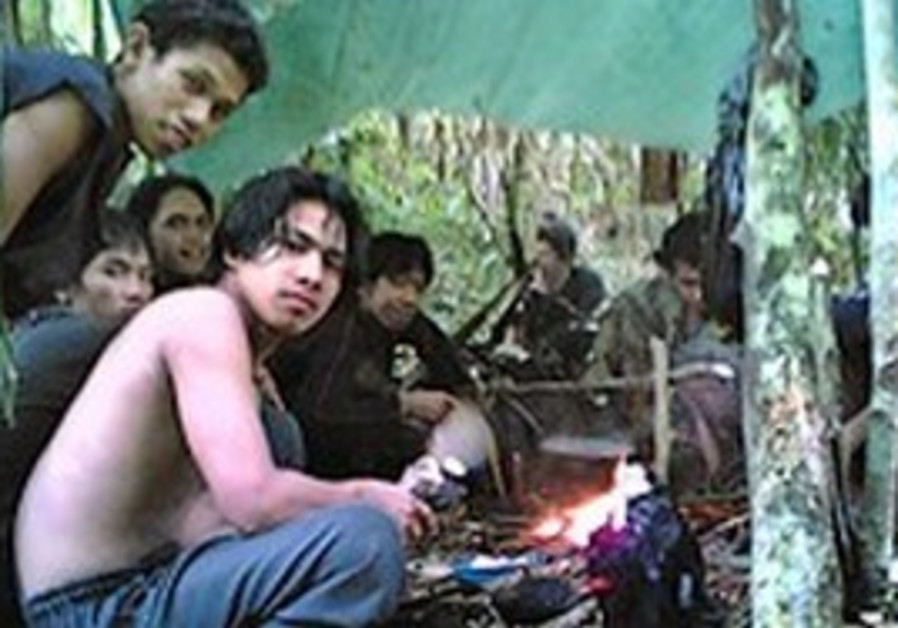 Members of Abu Sayyaf hiding out in the jungle