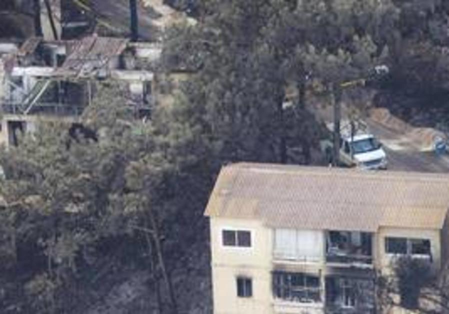 Burned homes at Kibbutz Beit Oren