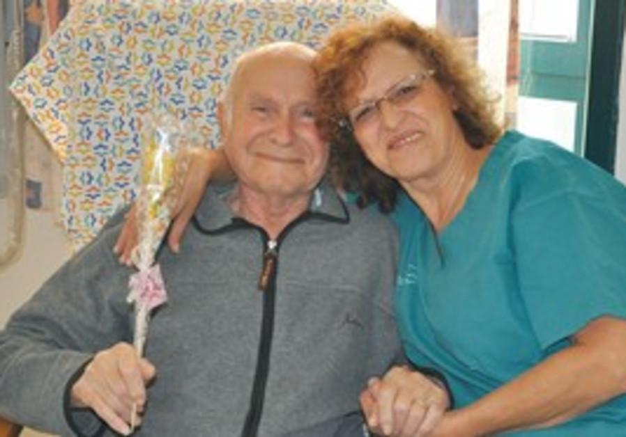 Nurse Josiann Shoshani hugs 80-year-old Avraham Ro
