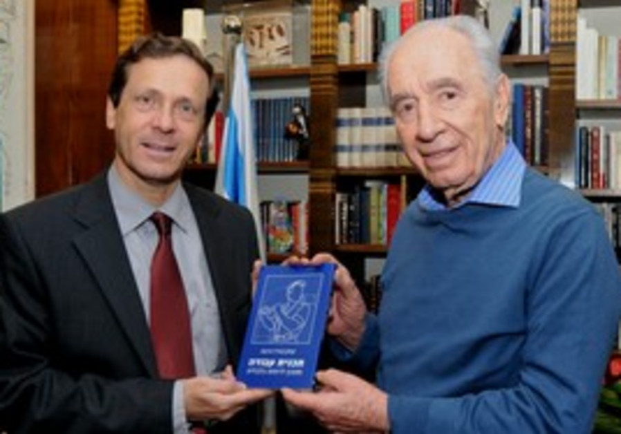 Isaac Herzog holds his new book with Shimon Peres.
