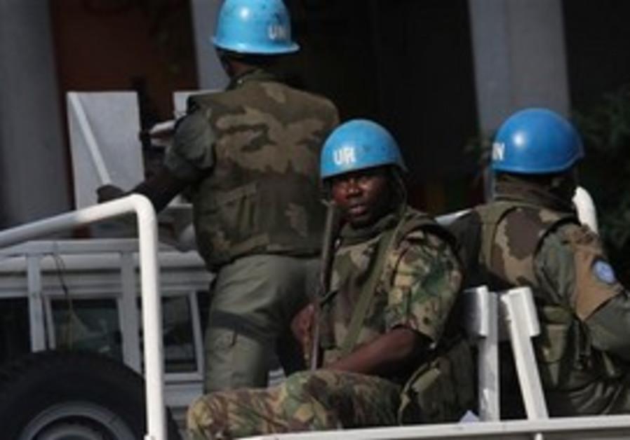 UN forces patrol a street, in Abidjan, Ivory Coast