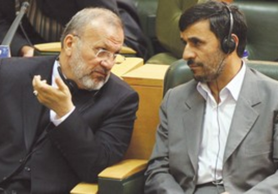 Manouchehr Mottaki with Ahmadinejad