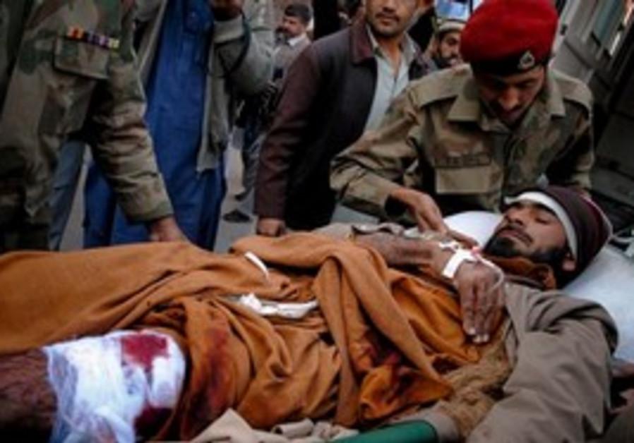 Pakistan army paramedic unload an injured victim