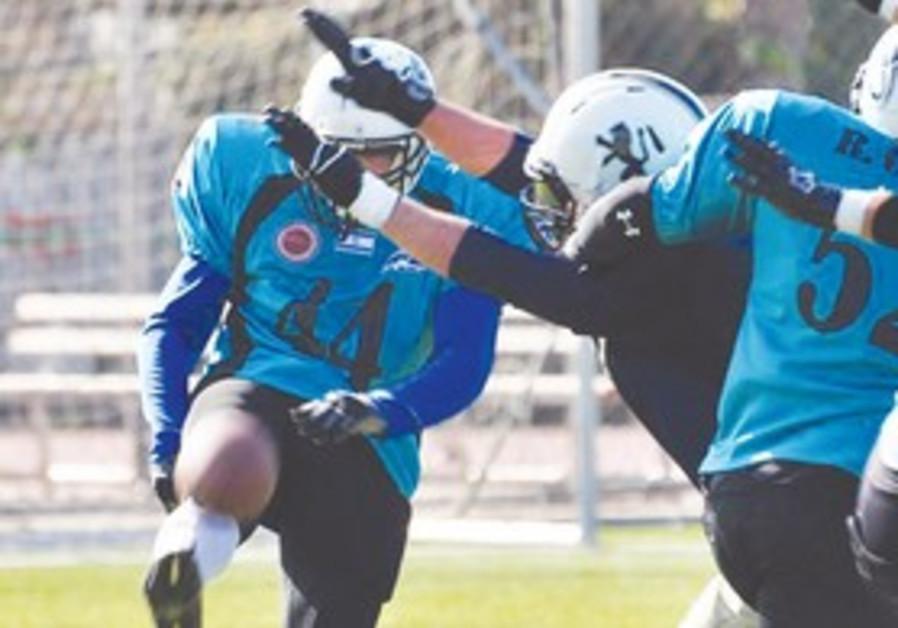 Blocked punt by Jerusalem Lions' defender.