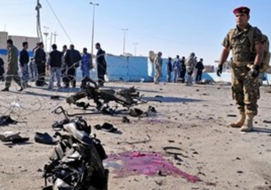 Security forces inspect blasts in Ramadi, Iraq.