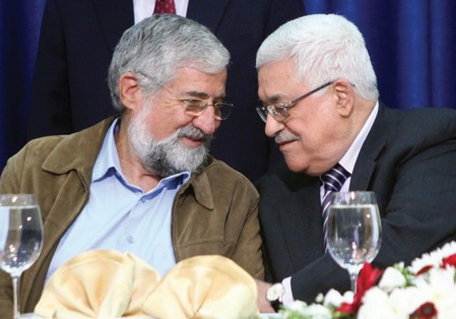 Amram Mitzna (left) with Mahmoud Abbas