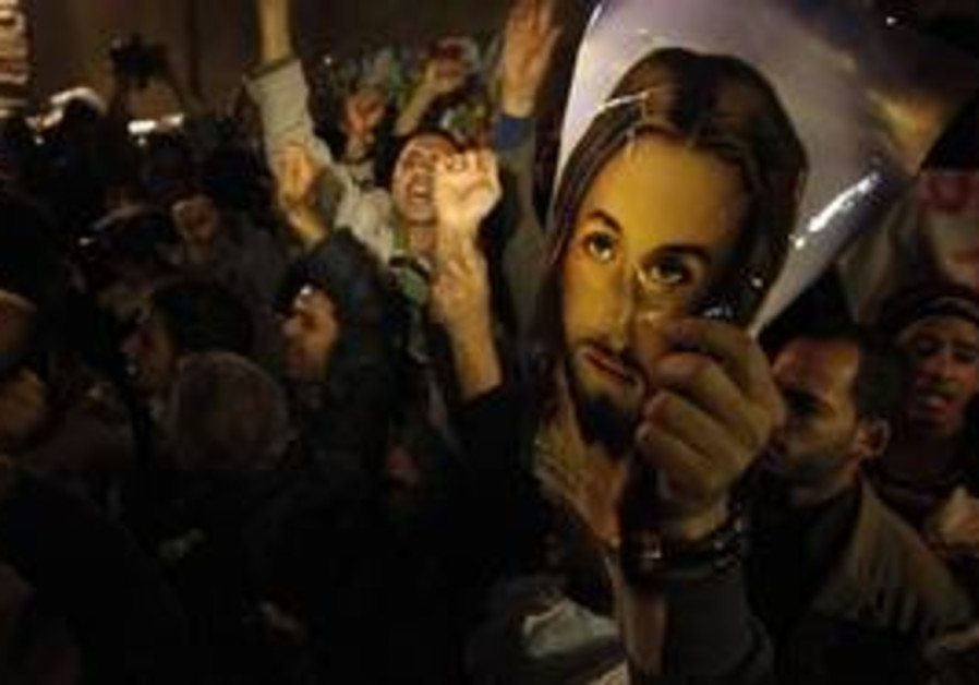 Angry Copts carry a picture of Jesus Christ