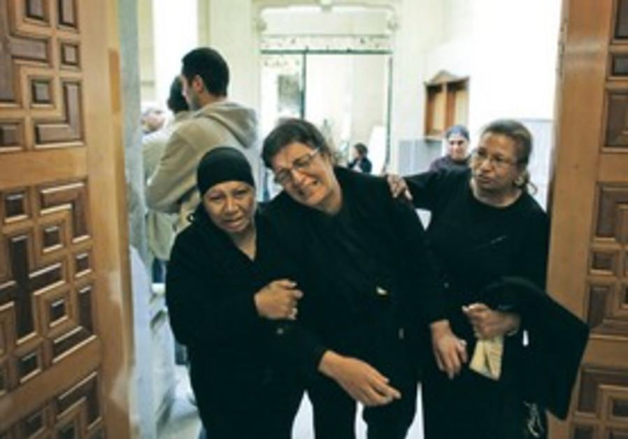 Grieving Egyptian Coptic Christians.