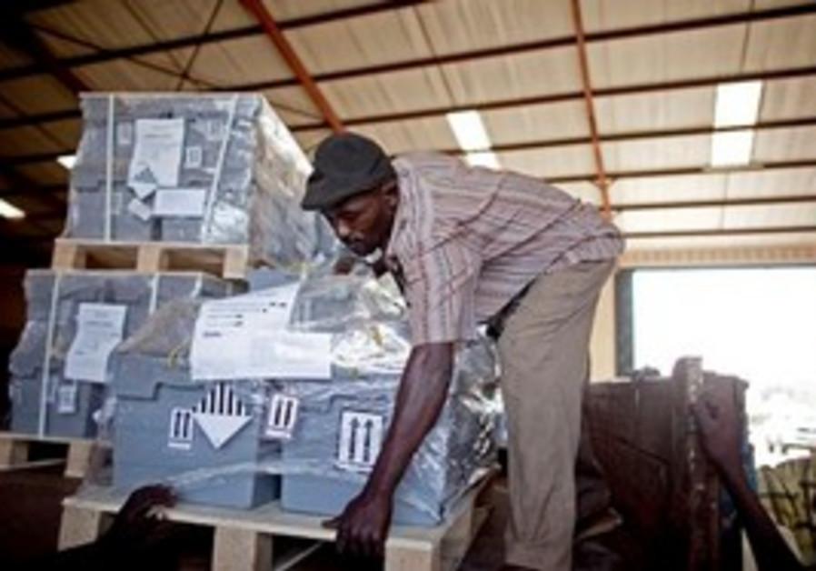 A S. Sudanese man stores referendum ballots.