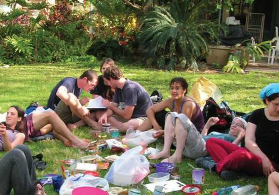 Students studying on grass in Jerusalem