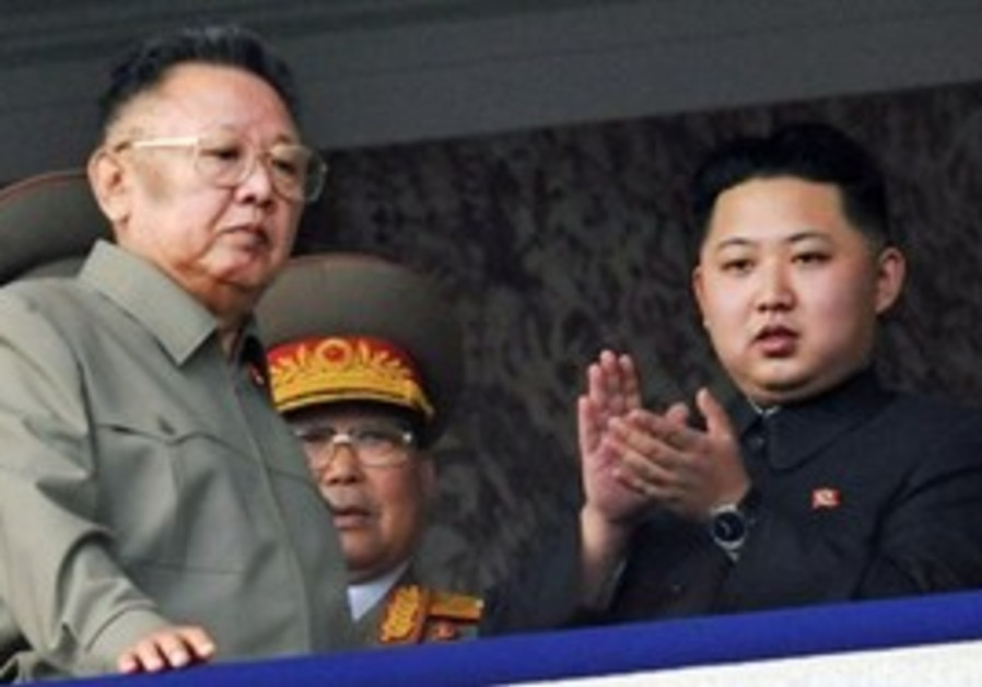North Korea leader Kim Jong Il with son