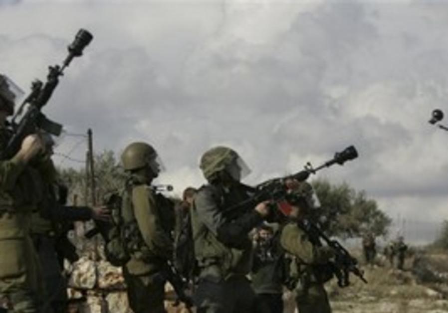 IDF soldiers firing stun grenades in Bil'in