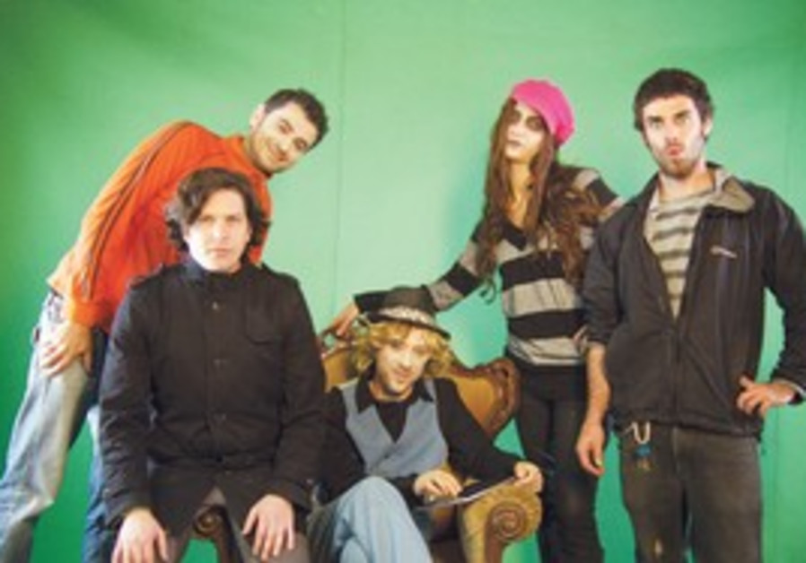 Ilan Dorot (in orange) and the creative team behin