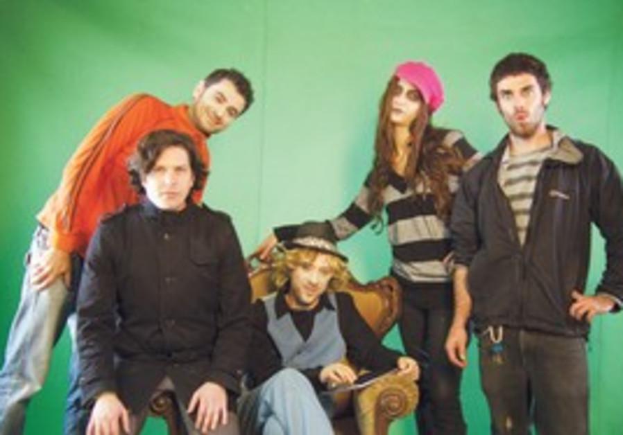 Ilan Dorot (in orange) and the creative team behin