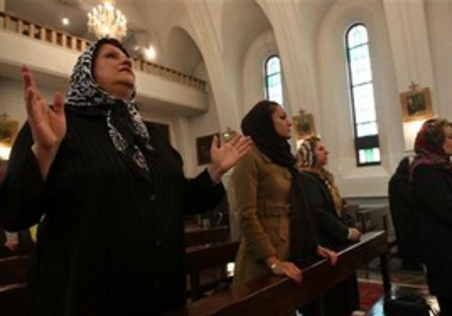 Christians attend mass at a Teheran church.