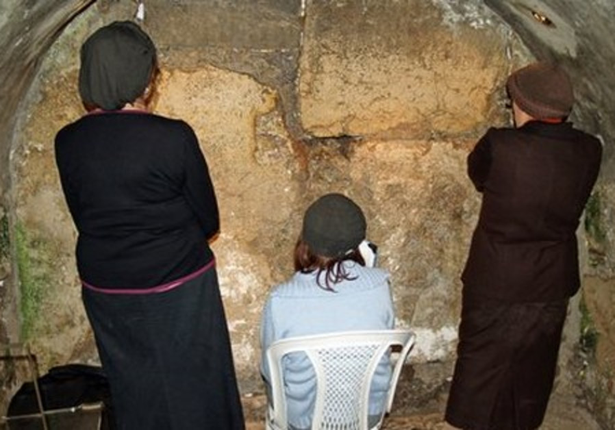 Religious women praying [illustrative photo]