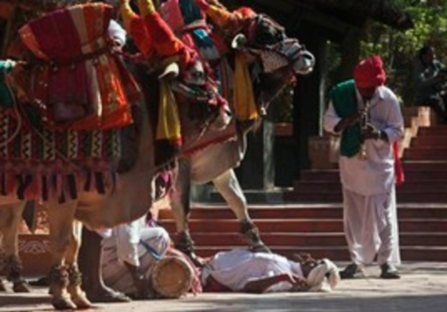 Indian men perform traditional stunts