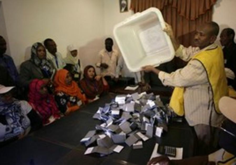 Poll staffer empties ballot box in S. Sudan
