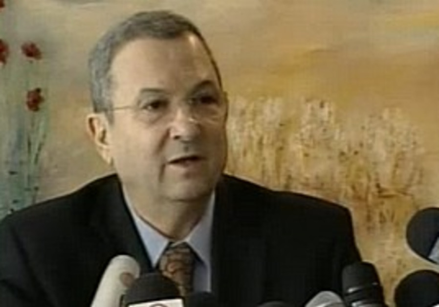 Barak speaks to reporters at the Knesset, Monday