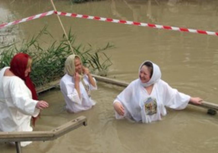 Pilgrims soak in the Jordan River
