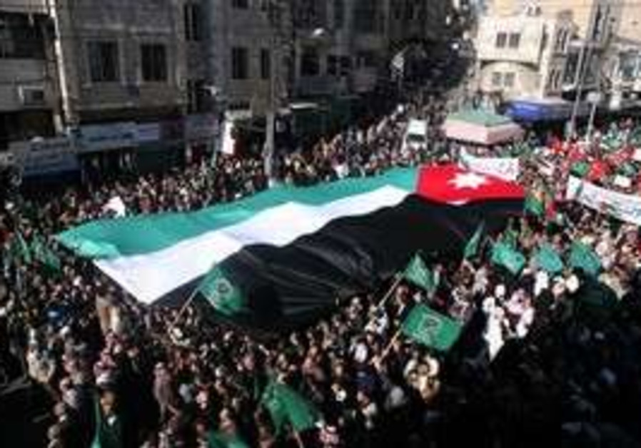 Protesters carry Jordanian flag in Amman