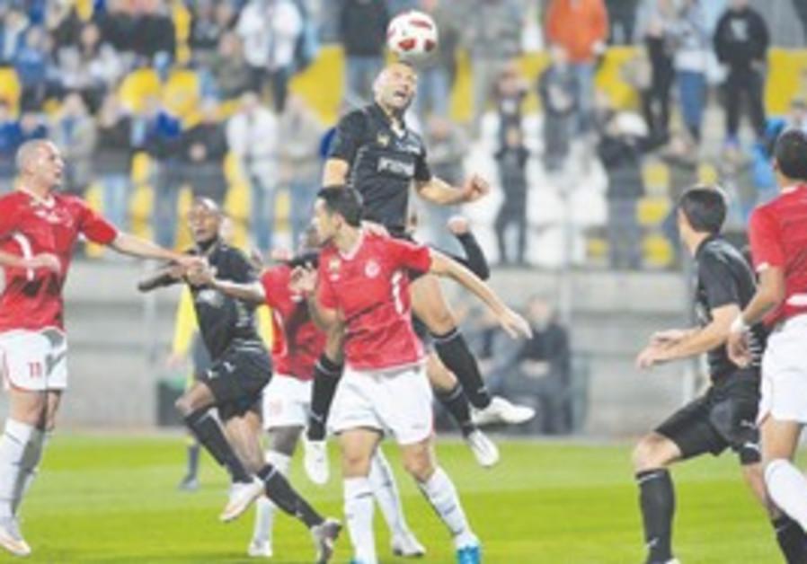 IRONI KIRYAT SHMONA defender Salah Hasarma rises a