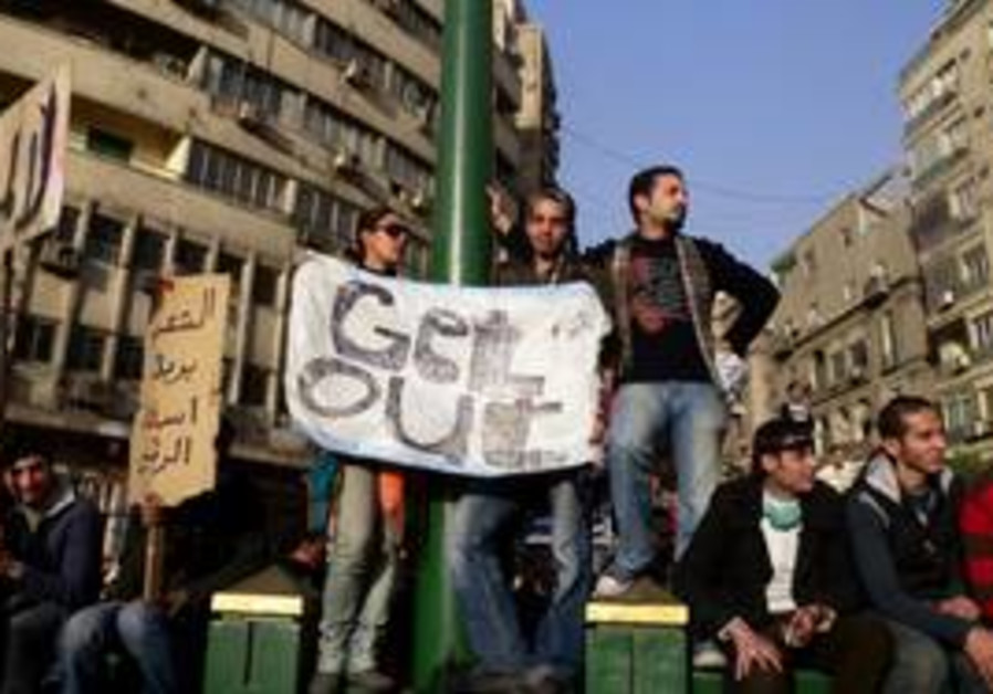 Egyptian protesters holding signs