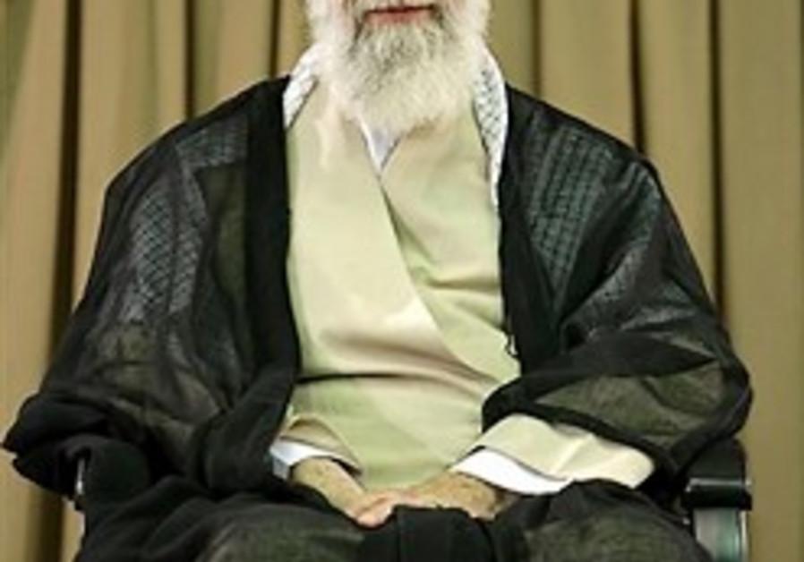 Iranian supreme leader Ayatollah Ali Khamenei sits
