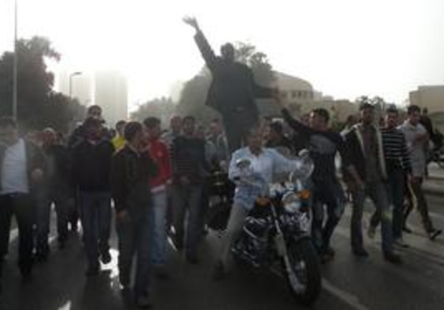 Egyptian protesters in Cairo with a motorcycle