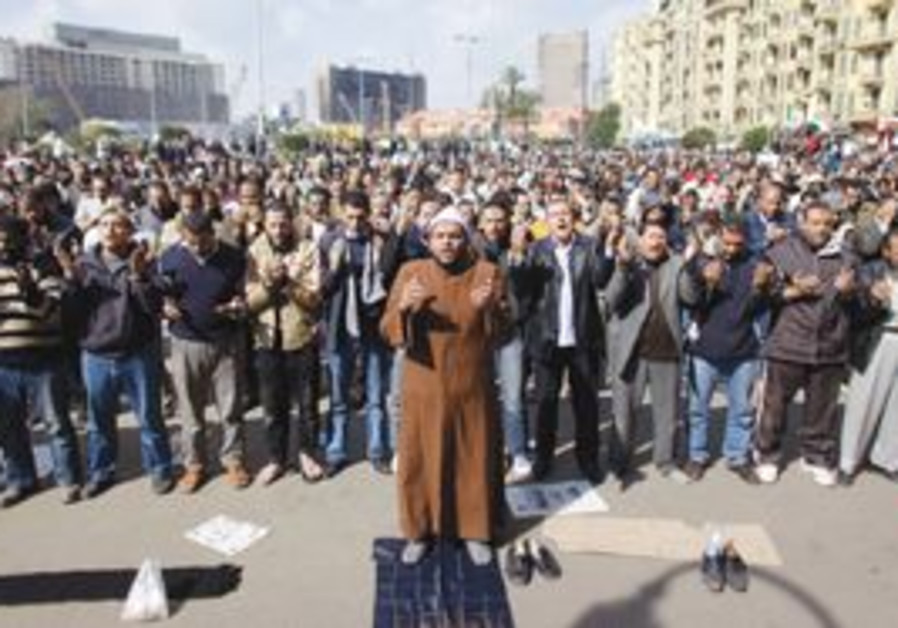 Egyptians praying in Cairo's Tahrir Square