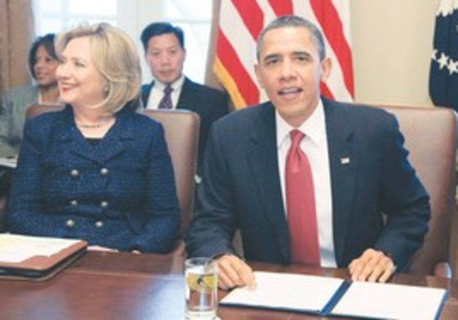 Clinton and Obama at a cabinet meeting, Tuesday.