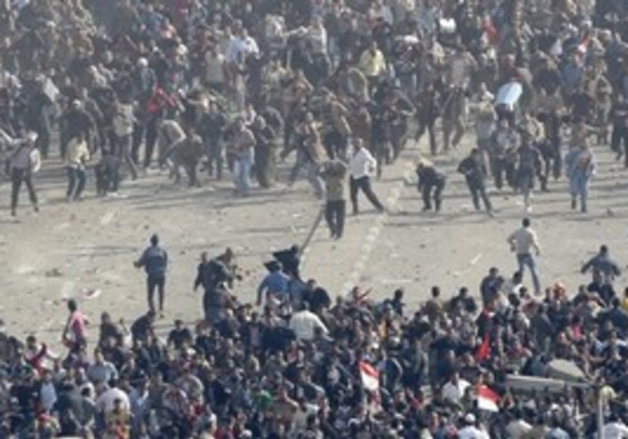 Demonstrators clash in Tahrir Square, Wednesday