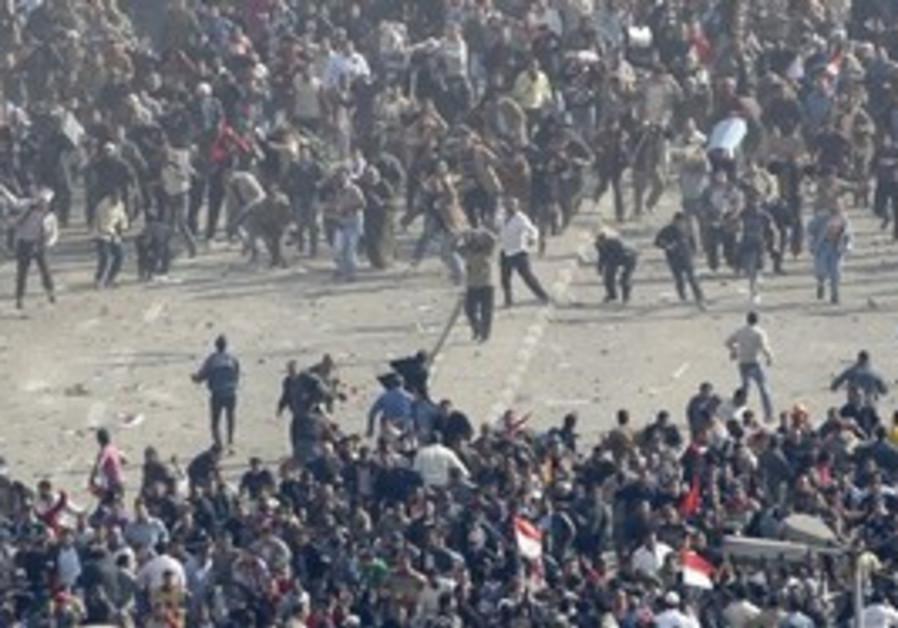 Demonstrators clash in Tahrir Square, Wednesday