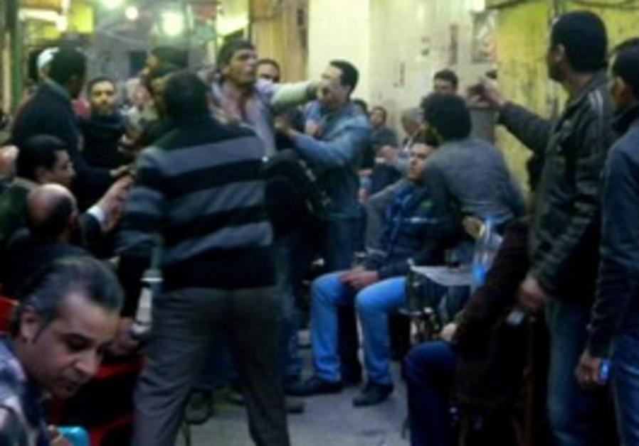 VIGILANTES TUSSLE with a suspect in coffee shop