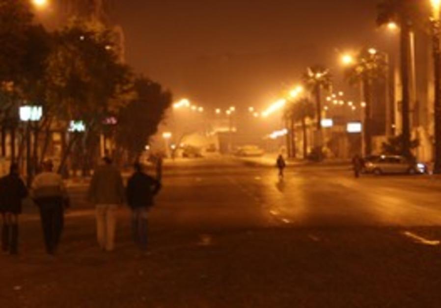 A LONE man walks down an empty street in Cairo