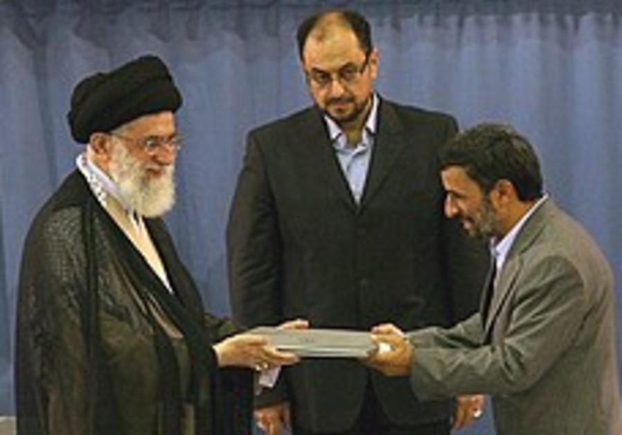 Mahmoud Ahmadinejad receives the presidential decr